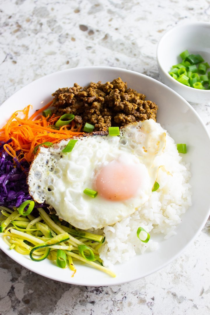 AIP Bibimbap with a fried egg on top.