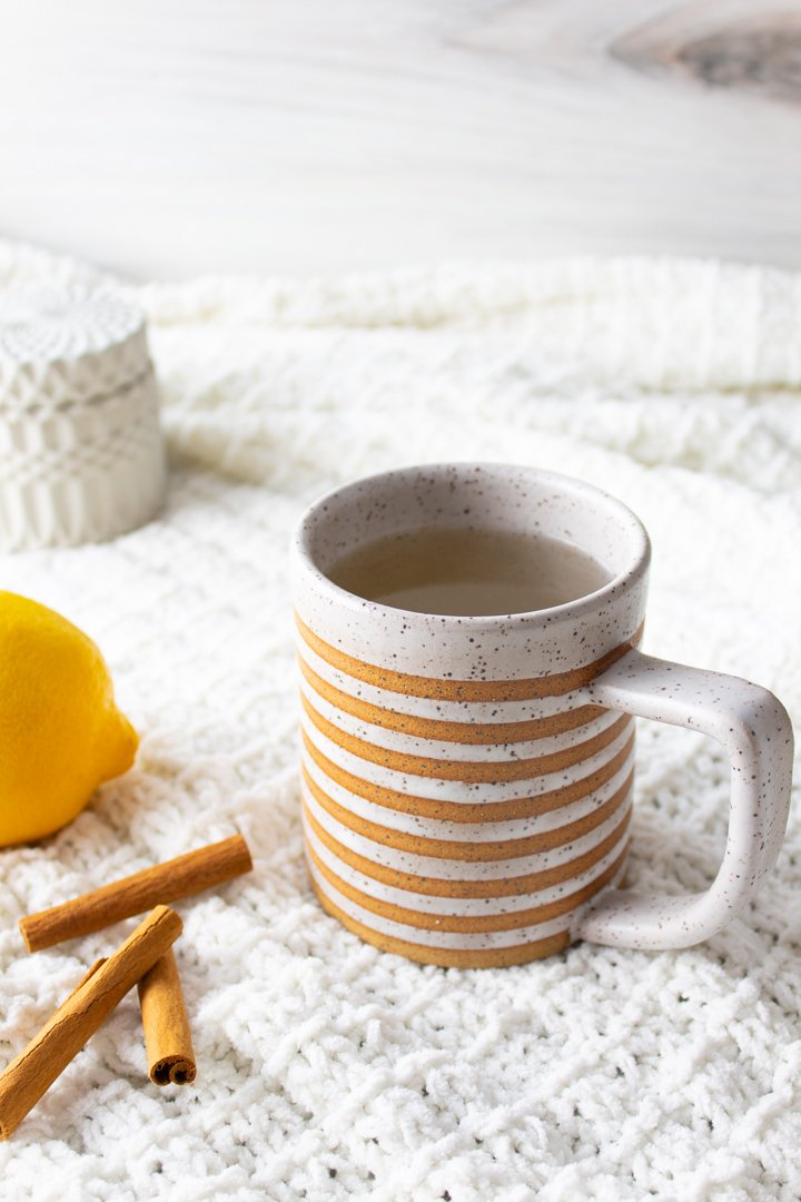 Spiced Honey Lemon Tea in a striped mug.