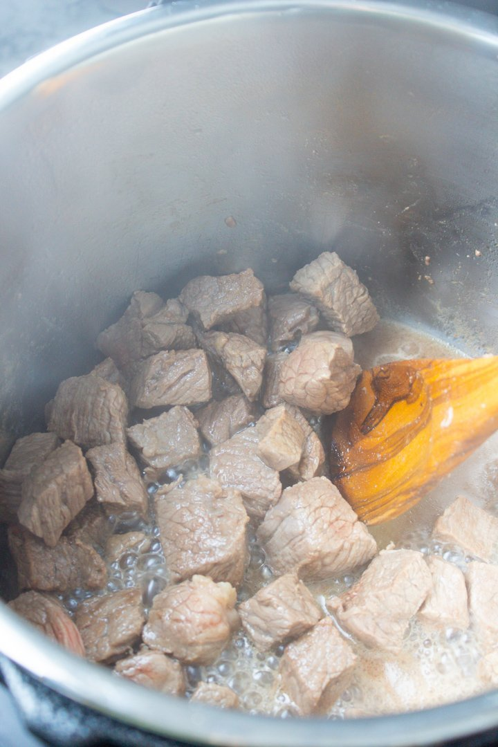 Close up of stew beef cooking.